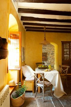 yellow breakfast nook in a Spanish farmhouse | El Mueble