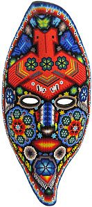 This beautiful, one-of-a-kind beaded mask was made by pressing tiny glass beads into natural beeswax spread over a paper-mache form.  Bead art is made in limited quantities by the Huichol and Tepehuano Indians of southwestern Mexico.  Click here for additional information on the Huichol people and how this art was made, and here for an Adobe Reader file describing the significance of their symbols and color choices.