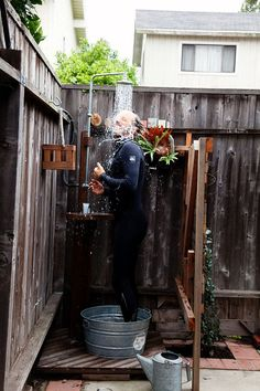 Outdoor shower-totally would work in my backyard...near the Gardening Station-to-be!