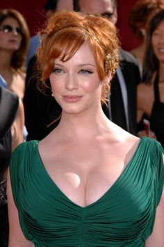 christina hendricks. i love her because she is a woman with real curves.