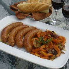 Italian Sausage, Peppers, and Onions - Have made this dish lots of times for a crowd. I always double, eliminate the red onion if I don't have one, add a yellow and orange pepper, sub red wine and add a large can of crushed tomatoes. Cook down for much longer and transfer to crockpot. Serve on hoagie buns. Delicious!!!!
