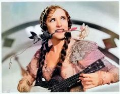 Uke lady with rose in teeth. Colorized by Steve Smith