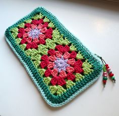 Granny Square Pencil Case/Makeup Bag/Sm Clutch   No Pattern, Pic Only.   4 grannys joined, sc boarder, line it (or choose a tighter square with no holes), add a zipper and a cute beaded zipper pull, wha-la!