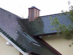 Metalldacheindeckung schwarz in Biberschwanz-Optik und Dachfenstereinbau durch die Rosenfeld & Krehl Dachbau Limited in Stahnsdorf OT Güterfelde (14532) | Dachdecker.com