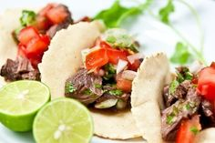"Carne asada or ""roasted meat"" is grilled beef marinated in lime juice, garlic cilantro and spices. Learn how to make carne asada tacos with this recipe. Tyler Florence, I Love Food, Good Food, Yummy Food, Tasty, Delicious Recipes, Carne Asada, Beef Recipes, Mexican Food Recipes"
