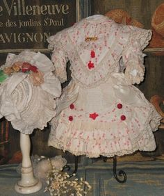 Very beautiful most hand sewn one of a kind outfit has generally excellent fabric and lace condition  from 19th. century and you will never find such