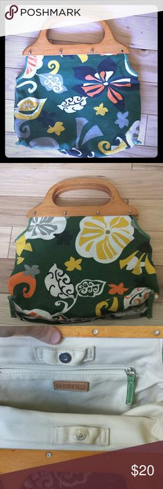 J crew floral green beautiful satchel so cute Really cute J.Crew clutch fabric floral design green with wood handles and great condition beautiful bag great for fall awesome bright colors would look really cute with a yellow or green or orange or even a black dress or can even be worn with a white dress or can be a great accessory with some cute jeans or a nice blouse that matches awesome non-smoking home fast delivery at a great price get it today and rock on J. Crew Bags Satchels
