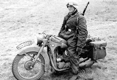 German Luftwaffe Motorcycle Messenger with a BMW R35. The License plate shows it belongs to the 7th Air District Command (Luftgau-Kommando VII).