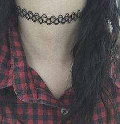 This is a tattoo choker, handmade by me.  It is one size fits MOST, it will stretch to fit snugly :)    If you are not sure if this will fit you than