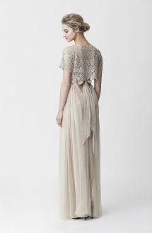 <p>.Lola: vintage gold macrame lace top embroidered with pearl and paillette.Lesya: metallic gold elastic tulle maxi skirt with a wide lace waistband that ends in a bow on the back..</p>