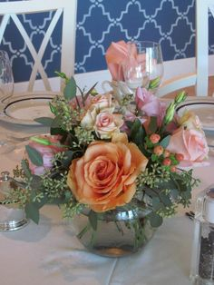 Peach, pink, and coral colors, this was a perfect combo next to our lakeside wedding.