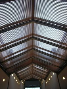 I.M. Pei Suzhou Museum - My favorite part is the ceiling. The entire roof is made of acrylic glass with natural lighting softened by wood screens.