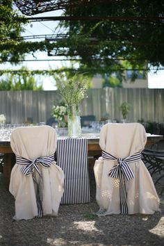 The bride and groom's striped chair ties match the table runners.