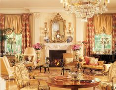 """""""Every seat in the house is comfortable,"""" says Stewart. """"I can't stand the thought of an uncomfortable chair."""" Touches of leopard print—a signature motif of his—dot the living room. Lee Jofa velvet on recamier. Brunschwig & Fils leopard velvet. Henry Calvin shade silk."""