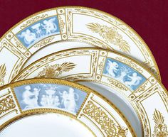 The raised, cloudy white pâte-sur-pâte decoration is carved to look like a cameo on a Minton dinner plate.