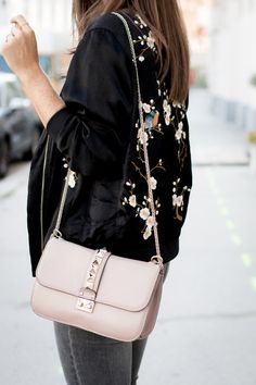 OUTFIT: floral bomber jacket + Valentino medium lock bag in powdery pink (p45) | Bikinis & Passports