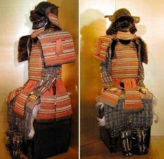 Kebiki Ni Mai Do Gusoku, a 2 piece hinged armor of 8 closely knit rows of scale plates. 7 rows of 5 kusazuri hang from the do. It has a 32 plate Suji Kabuto with a tehen Kanamono vent in the shape of a stylized chrysanthemum and prominent Fukigaeshi, with 5 Hineno Jikoro cascading down the back.