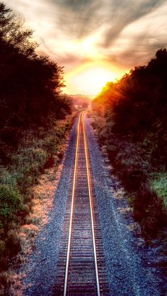 Something about train tracks and a sunset  source Flickr.com