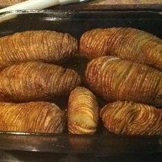 Baked potatoes sliced thin but not all the way through. Coat with butter, salt, and olive oil. Bake at 450 degrees for 60 minutes or until just beginning to brown! These are like a mix between chips and baked potatoes....so good! Serve with chives and sour cream if you like.