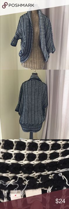 Anthropologie Moth Black White Cocoon Sweater XS Anthropologie Moth Black and White Cocoon Sweater Size XS. Good condition, there is fuzziness all throughout though due to material, see pics for material tag description. See pics for measurements. Anthropologie Sweaters