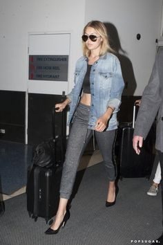 Pin for Later: Selena Gomez Isn't the First to Give Travel Sweatpants a High-Fashion Makeover Gigi Hadid Work a tight-fitting pair with pumps and a denim jacket. Roll up the sleeves to achieve a more stylized look.