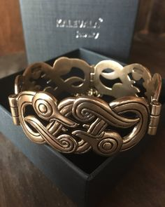 Treat yourself to something wonderful this holiday season! This #Kalevala bracelet reflects rich history and is the perfect conversation starter for your next story. #gold #history #baltic . . . . . . Shop Now: http://ift.tt/2kfiCgx