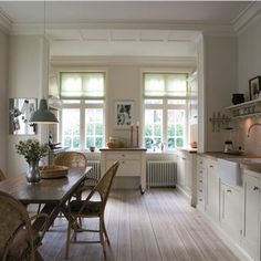 Kitchen painted in Farrow and Ball. Strong White emulsion on walls, Wimborne White eggshell on kitchen cabinets and All White on ceiling and trims. Love the bleached floor boards too. CD.