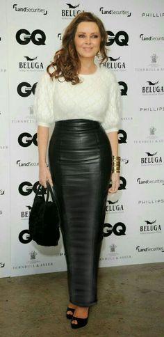Carol Vorderman wearing a long black leather pencil skirt