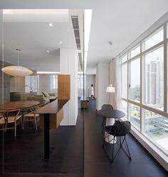 Only the kitchen meets the walls of the Wu Residence, while other rooms are surrounded by a single corridor that lines the perimeter.