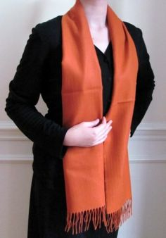 "#Winter #cashmere #scarf in orange on #sale at #YoursElegantly. Feel protected with the soft warmth and buy many colors at this discounted sale pricing. Our winter cashmere #scarves make unique gifts for any occasion.  Product No: 1756 Size 12""(width) x 64.5""(length) plus 3"" fringe Price: $29.99"