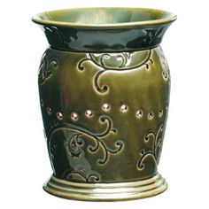 English Ivy Full-Size Scentsy Warmer    Vines and tendrils in shades of emerald green meander around English Ivy's pedestal base, while vent holes form a whimsical pattern to mimic the ivy scroll.