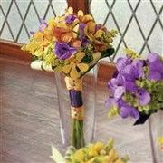 orange, yellow and purple orchid bridesmaid bouquet $105