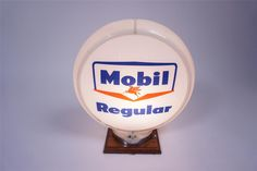 Sold* at Las Vegas 2016 - Lot #6142 Late-1950s Mobil Regular Gasoline service station gas pump globe in a Capcolite body.