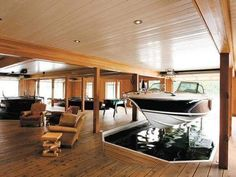 Hanging Out With the Boats in a Three-Boat Garage; For a true boat enthusiast, the height of luxury is a three-boat garage merged with a living area. Interior Architecture, Interior And Exterior, Interior Design, Beautiful Architecture, Garage Bateau, Boat Garage, Dream Garage, Home Fashion, My Dream Home