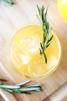 An old fashioned drink with a modern twist you'll love - this Whiskey Sour comes with freshly grated ginger and a fragrant rosemary sprig for a stir stick!
