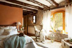 Dormitorio rústico en piedra y madera