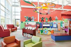 Artwork from Ashley Bryan's book Let It Shine brightens the Play, Learn and Grow children's area at the new Warrensville Heights Branch, Cuyahoga County Public Library, OH. Activity stations help to foster early literacy skills. CREDITS: HBM Architects, architect; photo, Kevin G. Reeves Photography