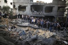 Palestinians gathered around a destroyed house after an air strike in Gaza City Sunday. | www.wsj.com |  Photo: Suhaib Salem/ Reuters