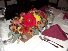 Wooden box arrangements with red gerbera daisies, mums, roses, seeded eucalyptus