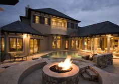Backyard with a pool and huge firepit..... yes please.