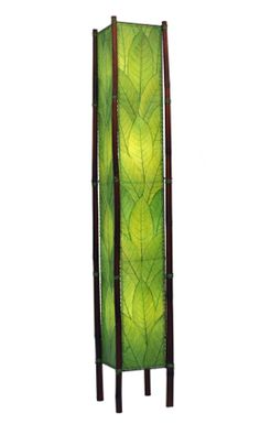 A simple and stunning lamp with real Cocoa leaves and sturdy bamboo legs. Fossilized cocoa leaves are handplaced and laminated on to a standard UL lamp backing, creating each of the four sides of the lamp. The panels are handstitched onto a powder coated, wrought iron frame to form a square design. Shown here in Green