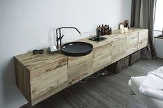 Black sink. Wood cabinet