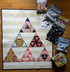 Eye Candy Quilts' Cotton and Steel Mini Quilt Swap project complete with extra goodies. My partner has twin boys, who obviously needed sidewalk chalk. And mom needs more fabric!!