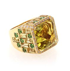 "Rodney Rayner ""Manhattan"" ring in 18 karat yellow gold set with diamonds, baguette lime quartz, tsavorites, and a cabochon lime quartz center stone. Stone weights are as follows: Center lime quartz is 17.24 cts, lime qrtz is 6.19 cts, tsavorites is 1.54 cts, and diamonds is 0.75 cts."