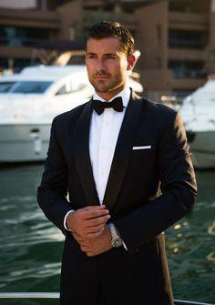 James Bond inspired Midnight blue tuxedo with black satin shawl lapel. 100% Italian Wool from Reda.