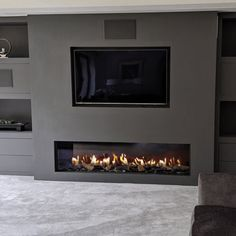 provide fireplaces for both inside and outside as well as bespoke fireplace solutions. And yes, you CAN have a TV above your fireplace! Feature Wall Living Room, Living Room Wall Units, Living Room Tv Unit Designs, Home Living Room, Living Room Decor Fireplace, Home Fireplace, Modern Fireplace, Fireplace Design, Living Tv