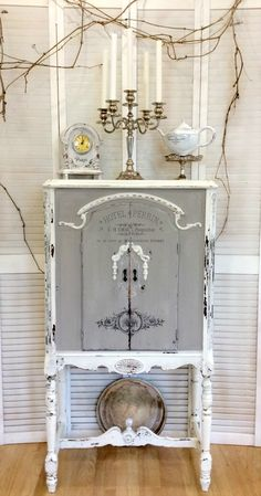 Refinished Antique Radio Cabinet, which was submitted by Rose. After painting the piece with 2 different shades of milk paint