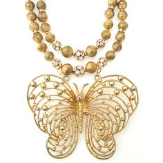 Large vintage brass butterfly pendant on a vintage 1960's gold and rhinestone double strand necklace