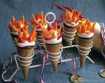 OLYMPIC TORCH CUPCAKES -- Celebrate the Olympics will these fun to make Torch Cupcakes! The flames are made with Candy Clay, it's like fondant, but taste a LOT better!
