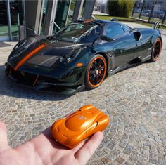 Pagani Huayra BC made made out of Green and Gray exposed carbon fiber w/ Orange accents Photo taken by: @shmee150 on Instagram Owned by: @gregb.23 on Instagram